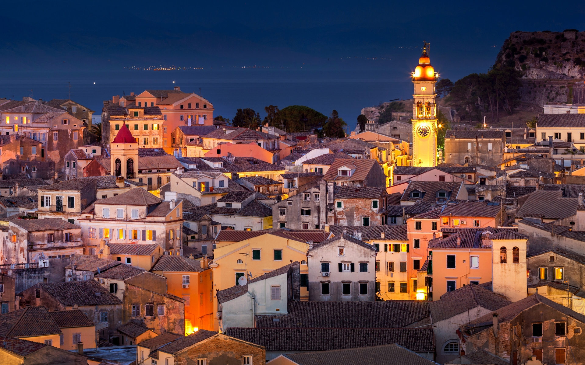 The town of Corfu ([image source](https://www.mylittleadventure.com/best-things/corfu/tours/corfu-by-night-private-tour-d2ZLkW5f))