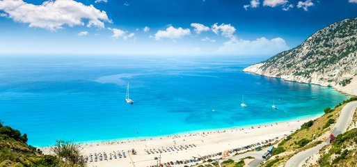 Kefalonia's Myrtos beach ([image credit](https://www.vehicle-rent.com/en/car-hire/greece/kefalonia/))